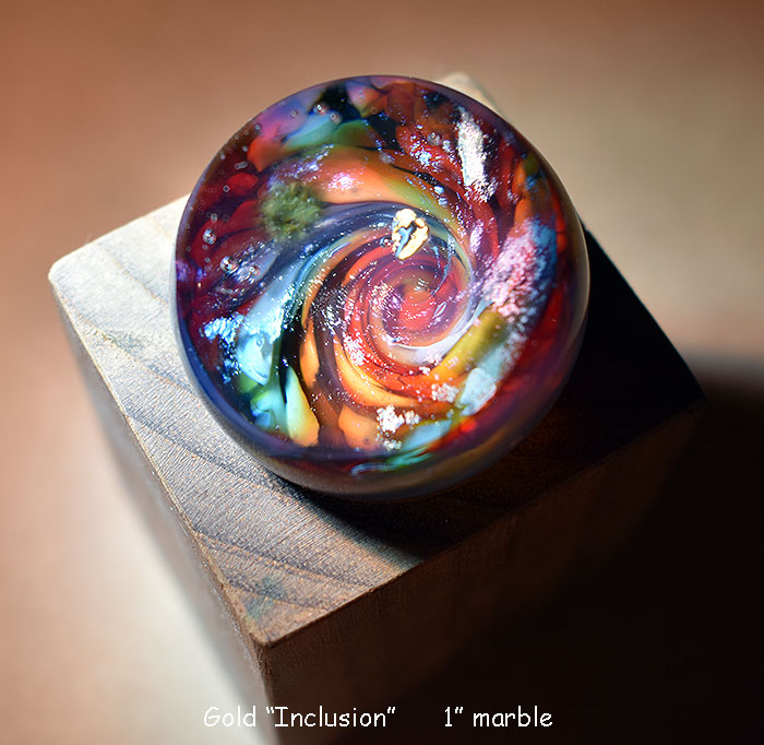 "Gold ""inclusion"", glass marble                  $175"